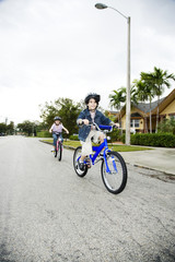 Two young children on bikes