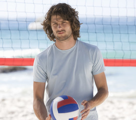 A man playing beach volleyball