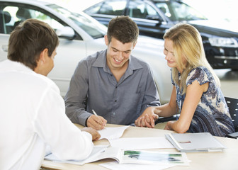 A young couple buying a new car