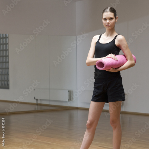 A young woman at a gym