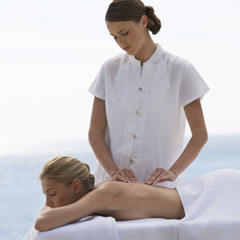 A young woman having a massage