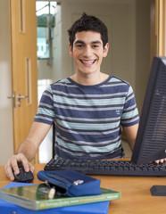A teenage boy using a computer