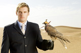 A man in a suit with a hawk