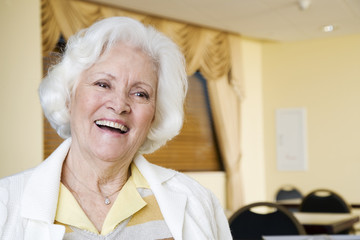 An elderly woman laughing