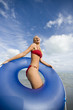 A woman in a bikini with an inflatable ring