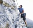 A climber climbing a rock face