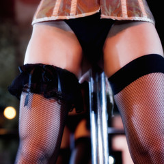 Close-up of a pole dancer