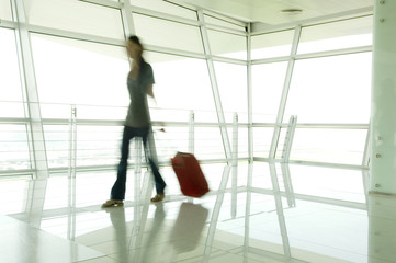 A woman walking through an airport