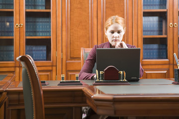 Business woman in classic wood working place