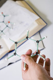 Benzene ring and sugar model on chemistry book poster
