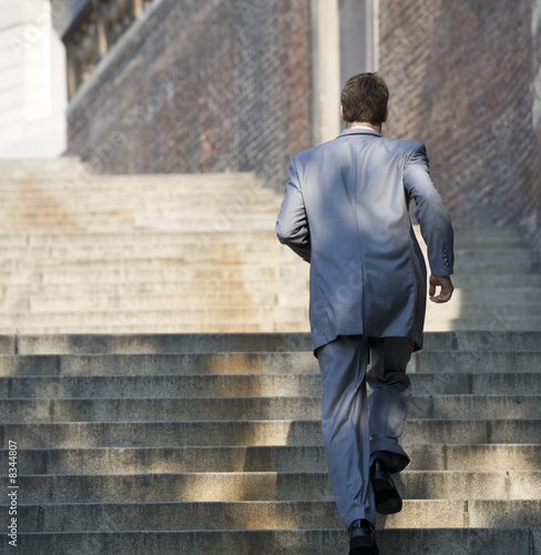 A groom running to the church