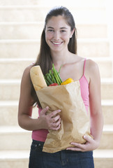 A young girl with a bag of shopping
