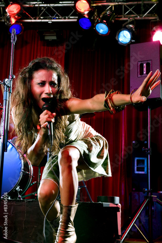 A young female singer performing