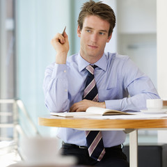 A businessman making a diary appointment