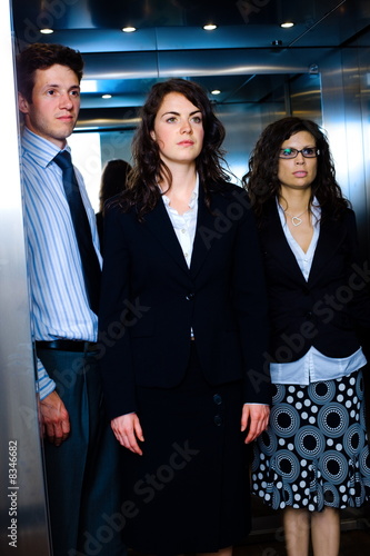Businesspeople in elevator