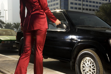 A businesswoman parking her car