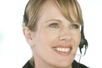 A young woman wearing an audio headset