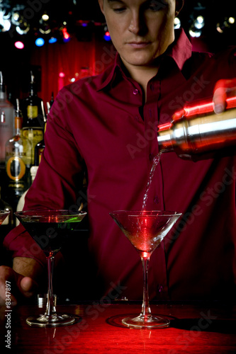 A barman mixing cocktails