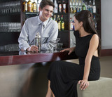 A barman flirting with a customer