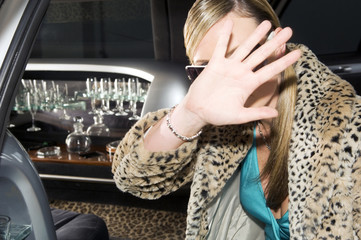 A woman in a stretch limousine