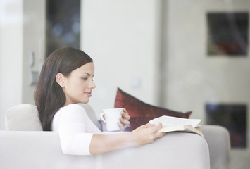 A young woman relaxing with a book