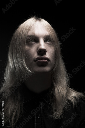 Young man with long blond hair