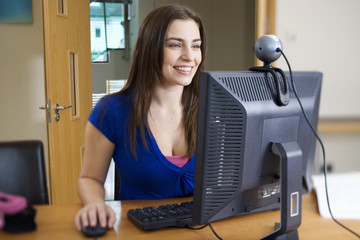 A teenage girl using a computer