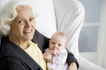 A grandmother holding her new grandchild