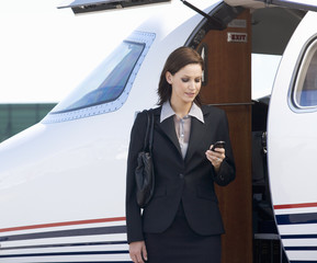 A business woman boarding a plane