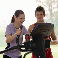 A young woman with a personal trainer