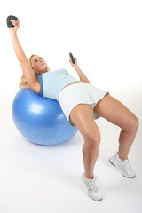 Woman Working Out With Exercise Ball