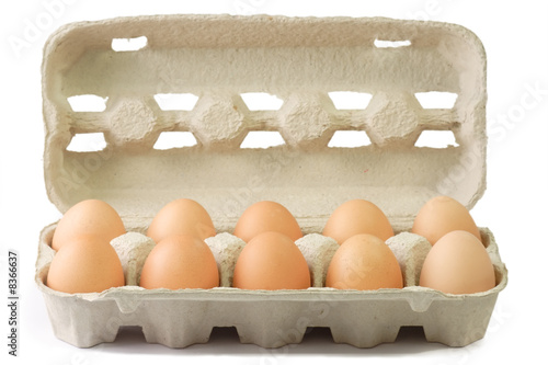 Leinwanddruck Bild Braune Eier im Pappkarton