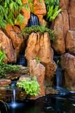 Japanese garden waterfalls, slow shutter. poster
