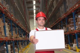 worker in uniform and hardhat carrying box in warehouse poster