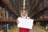 worker in uniform carrying box in warehouse poster
