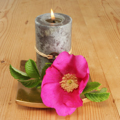 Candle and sinple rose