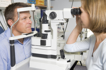 Optometrist in exam room