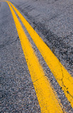 yellow dividing lines on the highway. poster