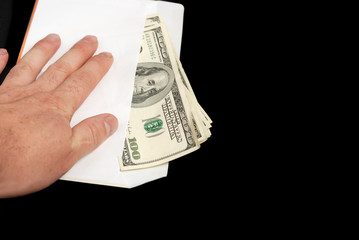 Bribe in an envelope and hand