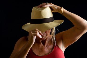 Senior Lady adjusting Hat