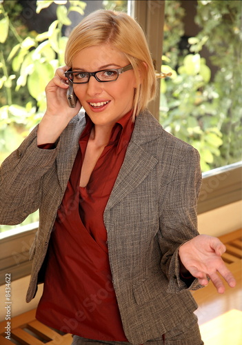 Young businesswoman sitting at office window