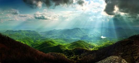 Sun rays mountain landscape