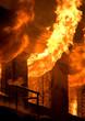 Leinwanddruck Bild - Old brick house on fire
