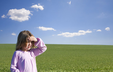 Young Girl in Lush Field under Blue Sky