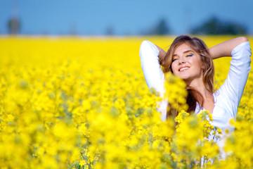 Girl relaxing in field of flowers