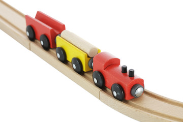 Wooden toy train on rail