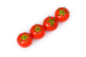 Row of tomatoes isolated on the white background