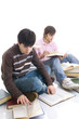 The two students with the books isolated on a white