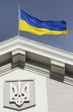Ukrainian flag waving on government building poster