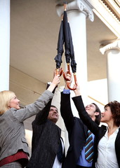 Business people reaching for the sky